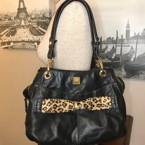Leather bag with calf hair bow